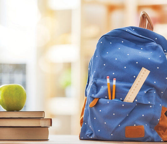 Apple, Pile Of Books And Pencils